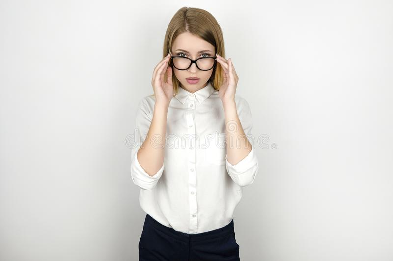 Young beautiful blonde business woman in eyeglasses after successful interview business meeting isolated white royalty free stock photos