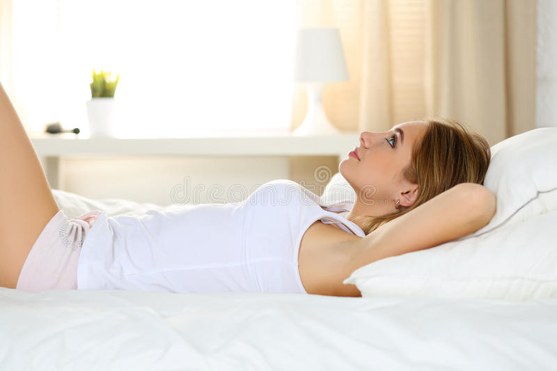 Young beautiful blonde smiling woman portrait wake up early morn stock image