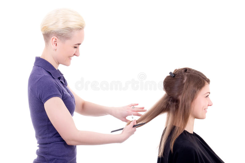 Young beautiful blonde woman hair stylist with client isolated o royalty free stock photography