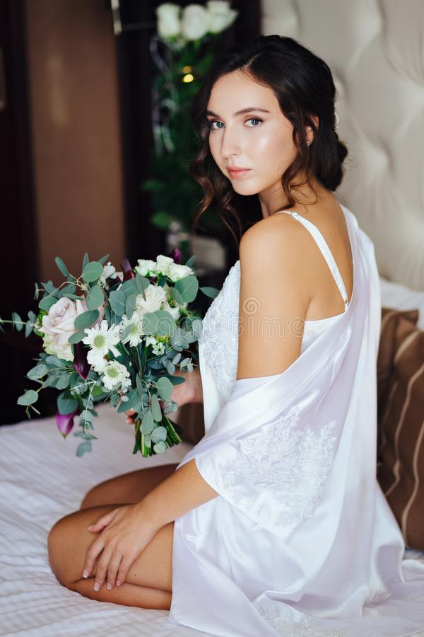 Bride with a wedding bouquet royalty free stock images