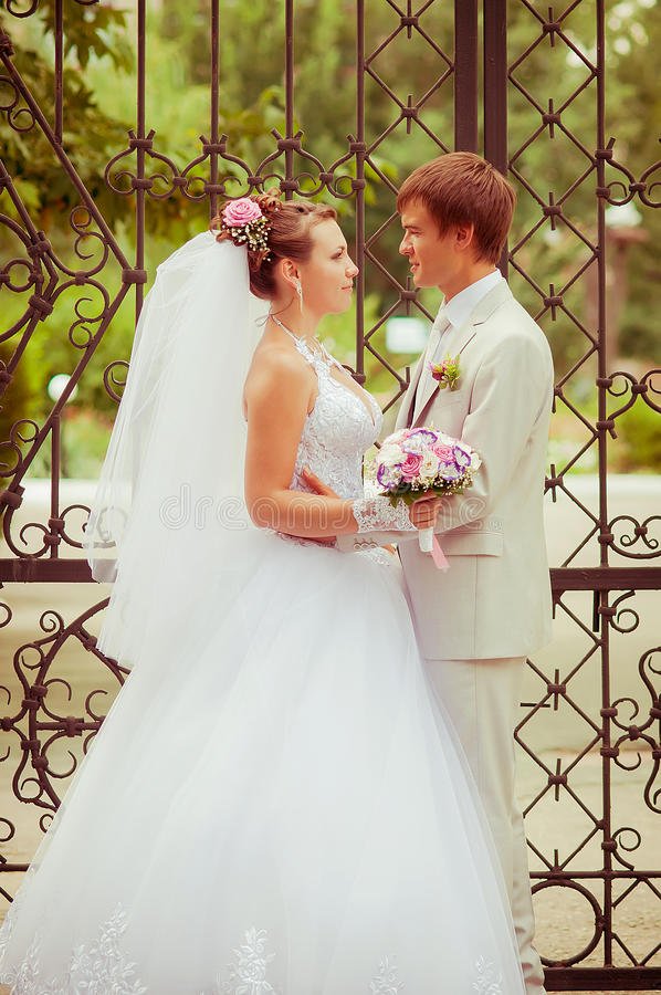 Download Young And Beautiful Bride And Groom Smiling At Eac Stock Photo - Image: 32900812