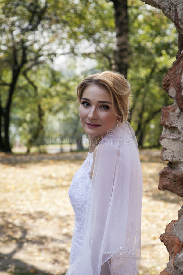 Young beautiful bride outdoors stock photo