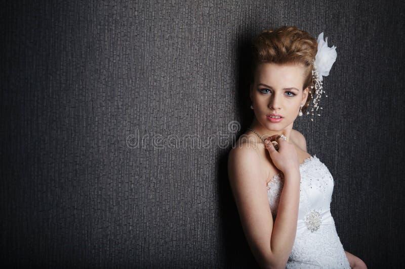 Young beautiful bride in wedding dress stock photos