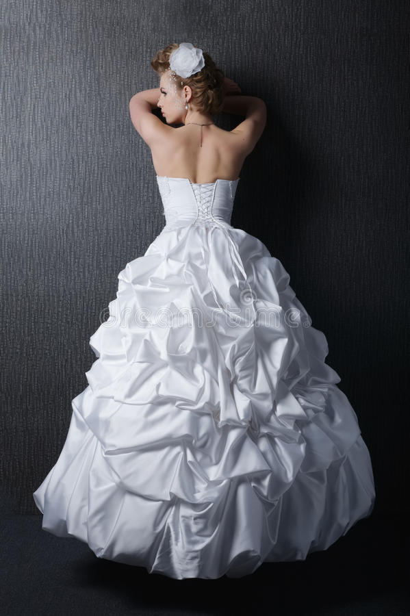Young beautiful bride in wedding dress royalty free stock images