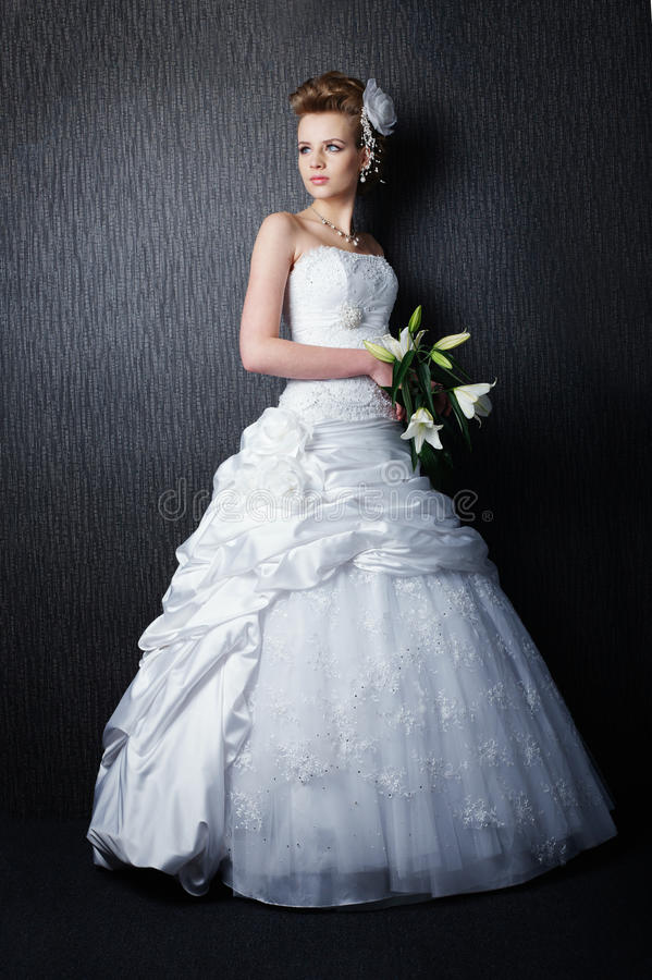 Young beautiful bride in wedding dress stock photo