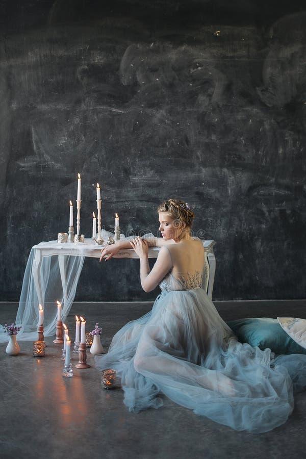Young beautiful bride in wedding dress posing in studio stock image