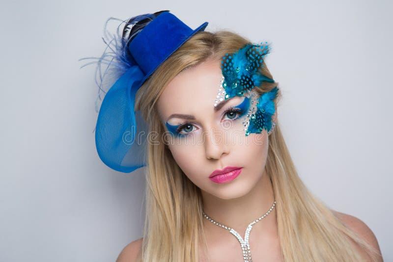 Woman blue bird stock images
