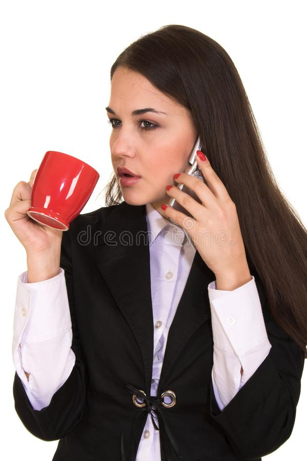 Young beautiful brunette talking on mobile phone stock photography