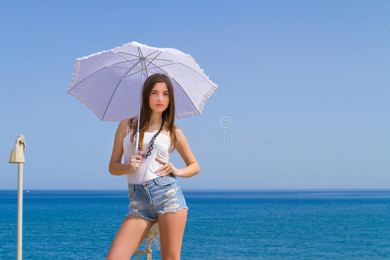 Young beautiful brunette with white umbrella royalty free stock photos