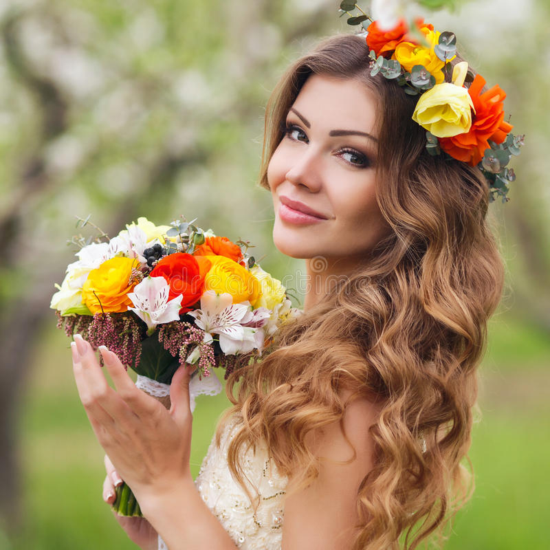 Young beautiful brunette woman in blooming garden stock photos