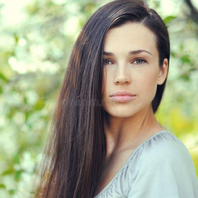 Young beautiful brunette woman face - closeup portrait stock images