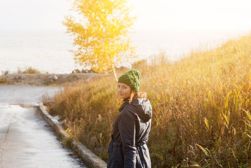 Brunette woman walking stock images