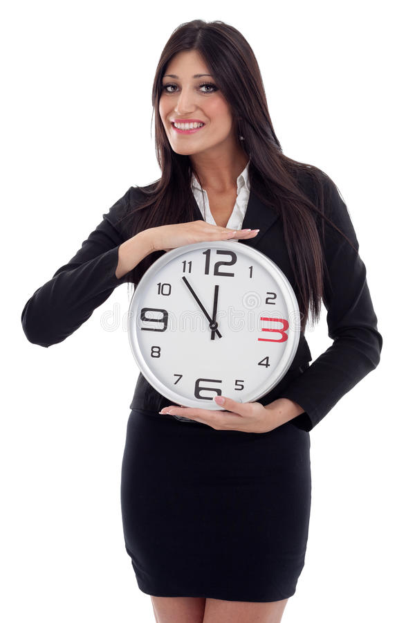 Young beautiful business woman with the clock stock photography