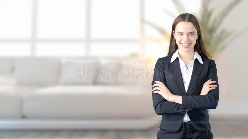 Young beautiful business woman and creative designer standing over blured interior background stock image