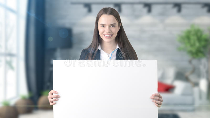 Young beautiful business woman and creative designer standing over blured interior background stock photos