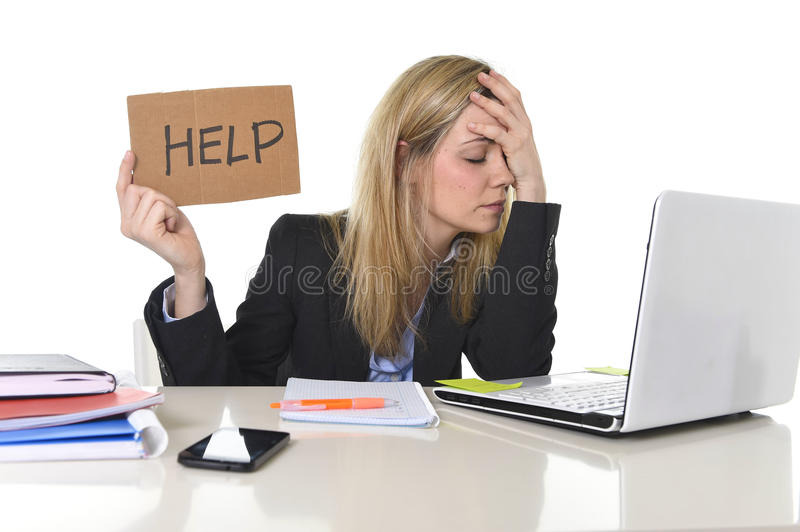Young beautiful business woman suffering stress working at office asking for help feeling tired stock photography