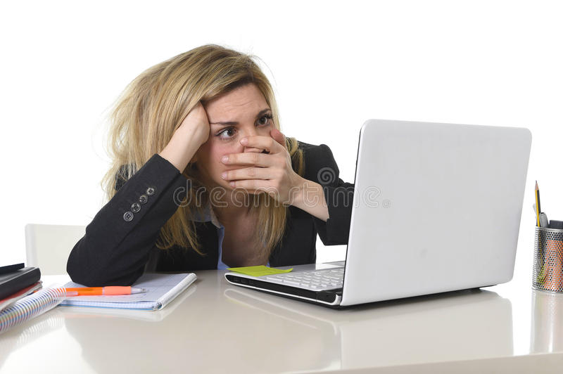 Young beautiful business woman suffering stress working at office frustrated and sad royalty free stock image