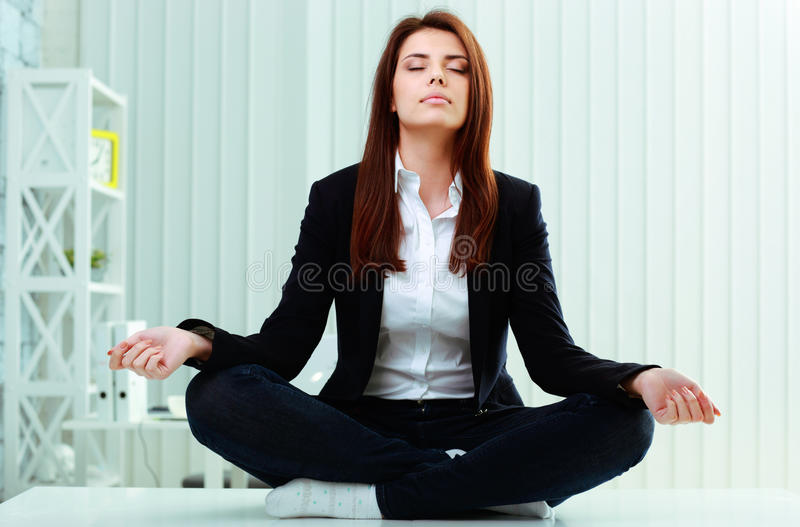 Download Young Beautiful Businesswoman Meditates On The Table Stock Images - Image: 35771464