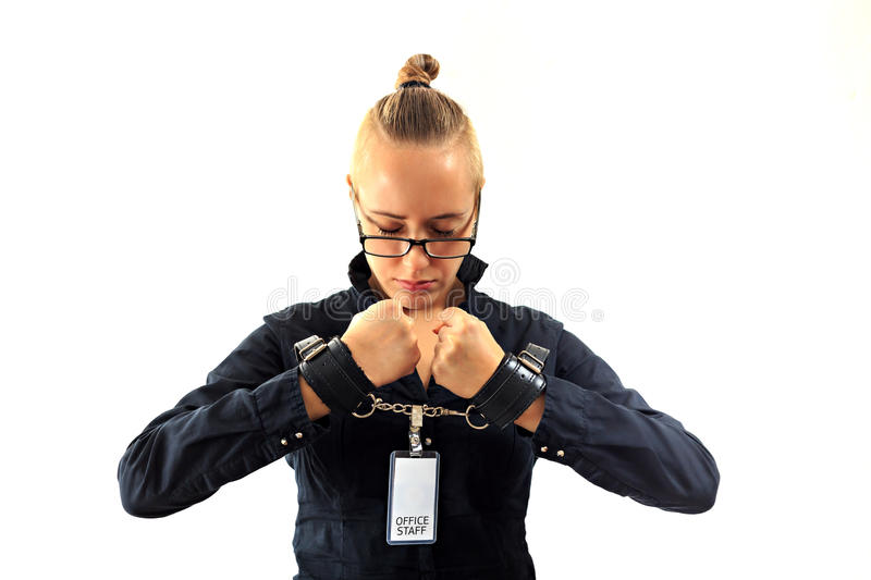 Young beautiful businesswoman screaming, prisoner of job in cuffs. Young beautiful businesswoman screaming with anger, prisoner of job in cuffs, isolated on royalty free stock photo