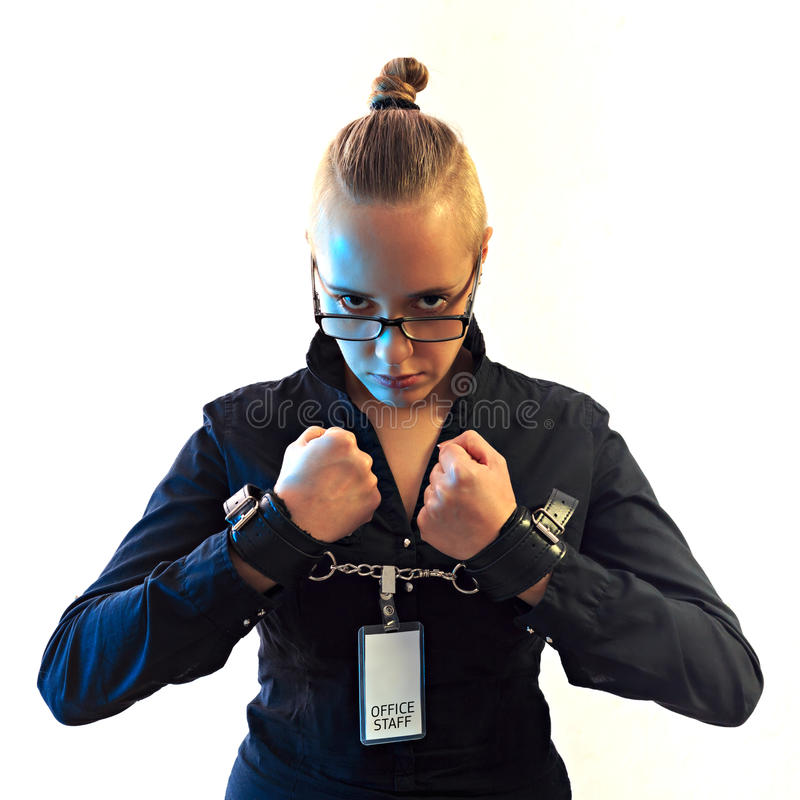 Young beautiful businesswoman screaming, prisoner of job in cuffs. Young beautiful businesswoman screaming with anger, prisoner of job in cuffs, isolated on stock photography