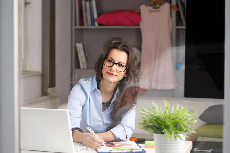 Young beautiful businesswoman working at home stock photography