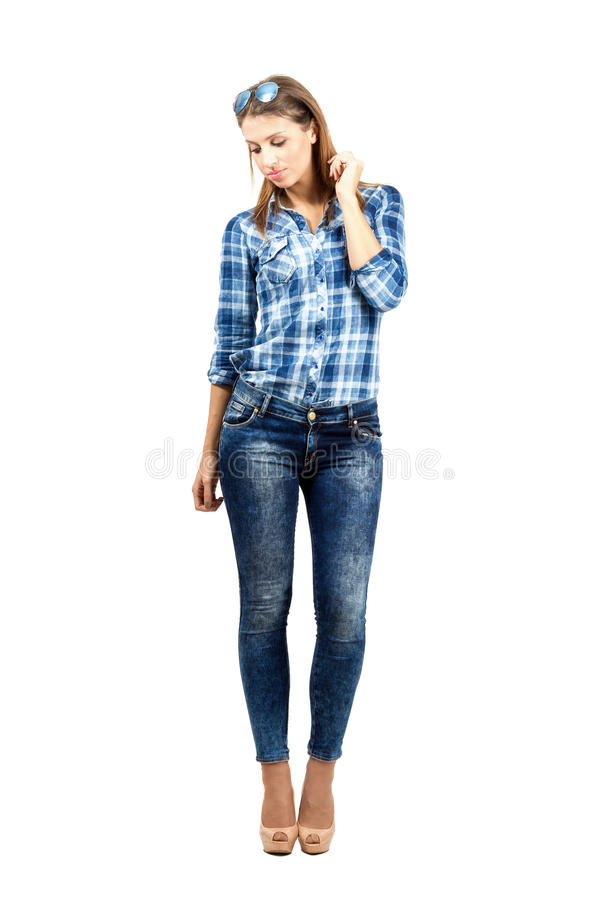 Young beautiful casual female fashion model looking down royalty free stock photos