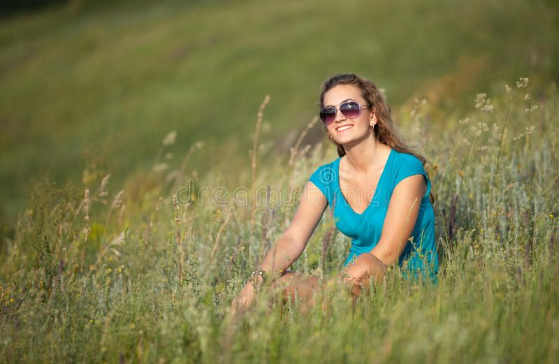 Young and beautiful caucasian girl with long hair in sunglasses royalty free stock images