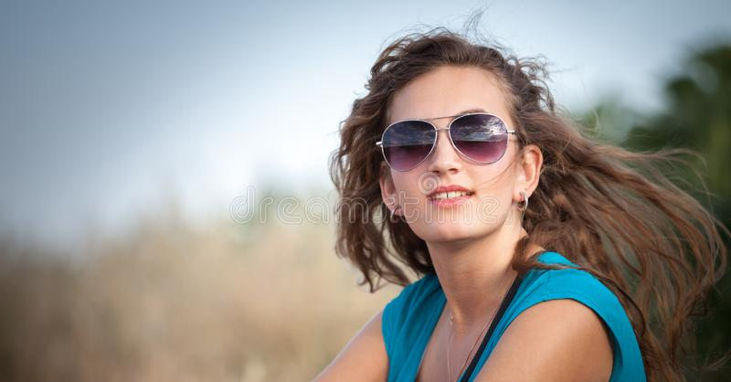 Young and beautiful caucasian girl with long hair in sunglasses royalty free stock photo