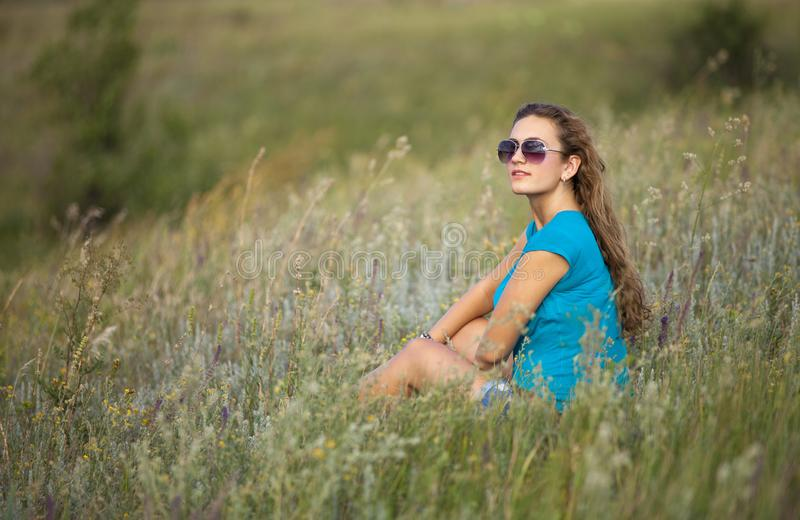 Young and beautiful caucasian girl with long hair in sunglasses stock images