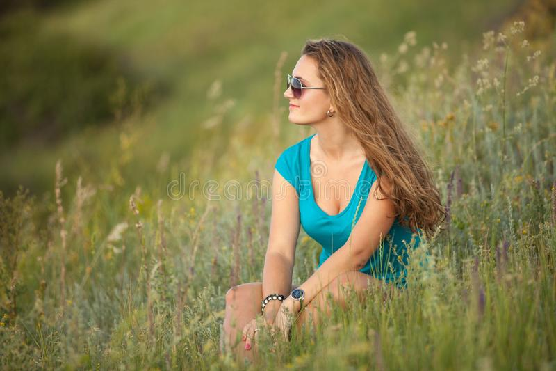 Young and beautiful caucasian girl with long hair in sunglasses royalty free stock photography