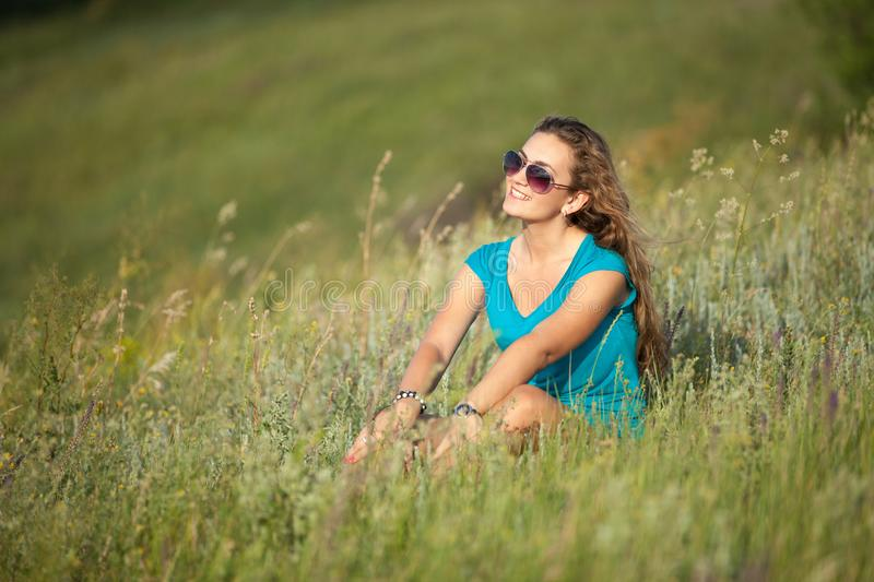 Young and beautiful caucasian girl with long hair in sunglasses stock photo