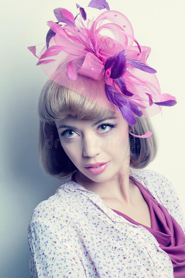 Young beautiful caucasian woman with fancy hat royalty free stock photography