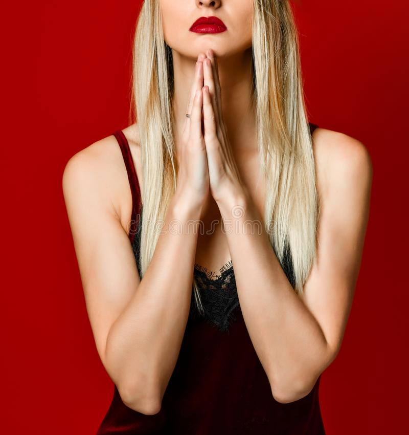 Young beautiful caucasian woman in kokoshnik cap praying with hands together asking for something o stock photography