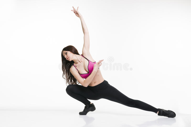 Young beautiful caucasian woman in yoga pose in studio on white background royalty free stock photo