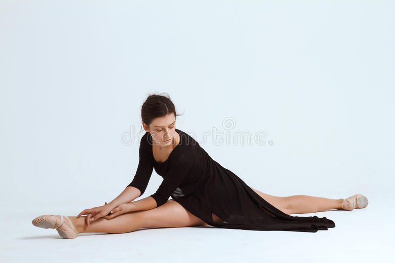 Young beautiful contemporary dancer posing over white background. Copy space. Young beautiful contemporary brunette dancer posing over white background. Copy stock photos