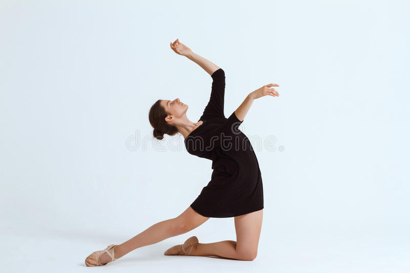 Young beautiful contemporary dancer posing over white background. Copy space. Young beautiful contemporary brunette dancer posing over white background. Copy royalty free stock images