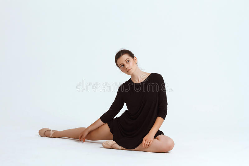 Young beautiful contemporary dancer posing over white background. Copy space. Young beautiful contemporary brunette dancer posing over white background. Copy stock photography