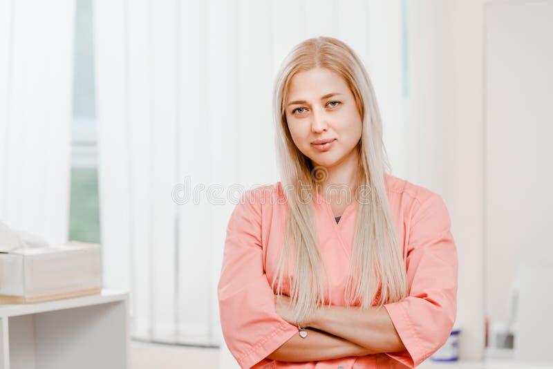 Young beautiful cosmetologist stock photo