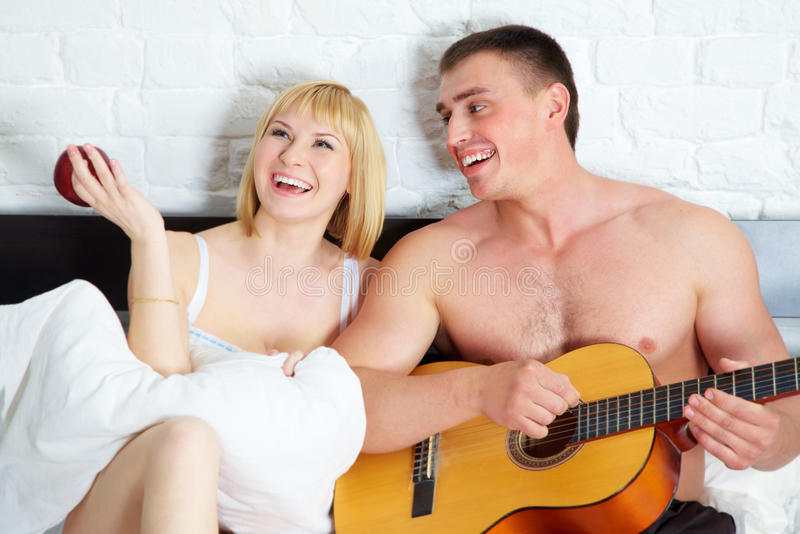 Download Young And Beautiful Couple With Guitar Stock Image - Image: 21725675