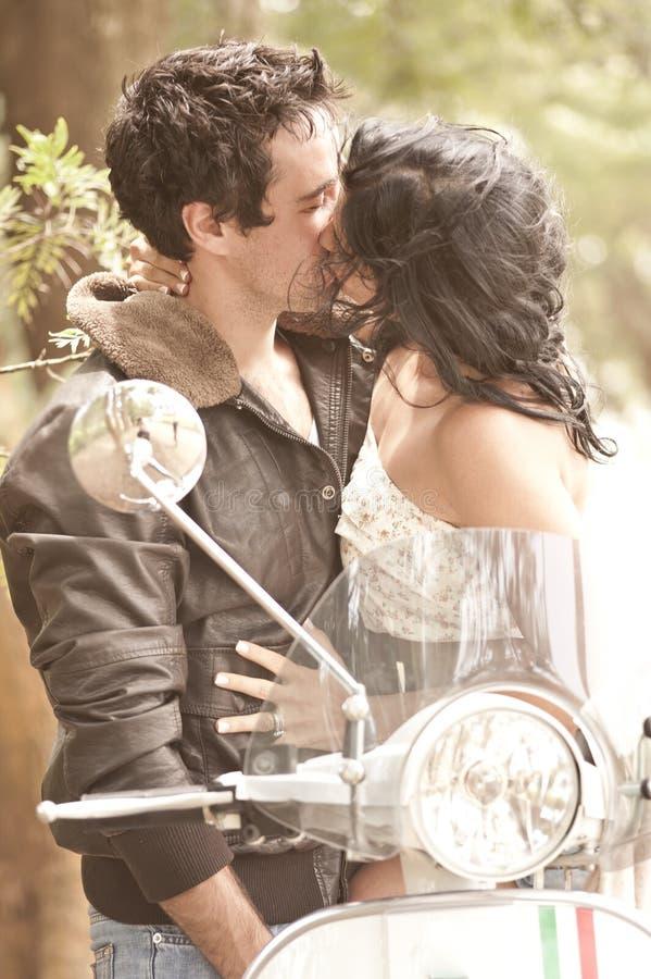 Young beautiful couple having fun kissing outdoors stock photos