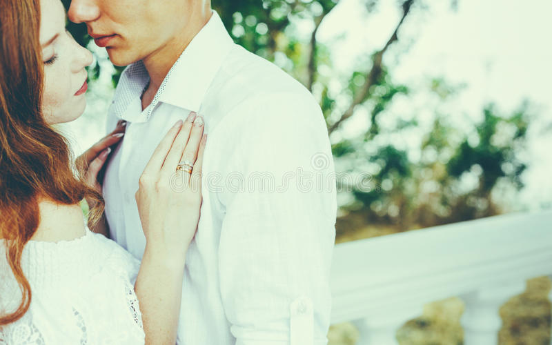 Young Beautiful Couple In Love Hug Each Other In Summer Park. Enjoying Together Romantic Concept stock images