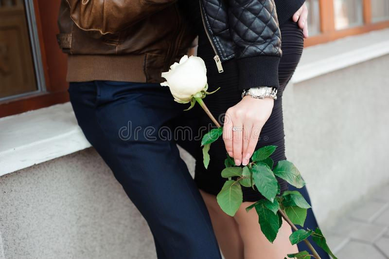 Young beautiful couple in love posing outdoor in city. Young wom royalty free stock photography