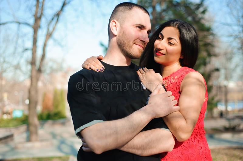 Young beautiful couple in love posing outdoor in city. Young woman smiling with her handsome man. royalty free stock photography