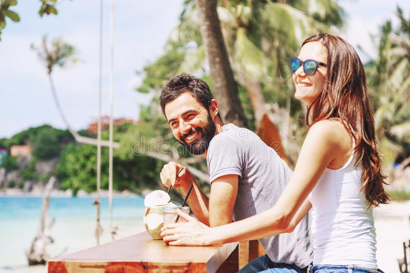 Young beautiful couple in love on the tropical sea, in beach cafe during a honeymoon holiday, Valentine`s Day. Love concept. royalty free stock photo