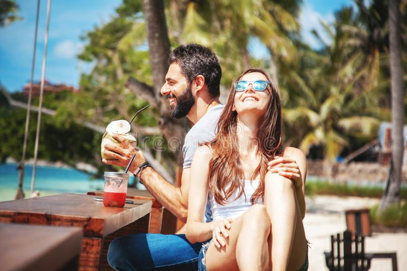 Young beautiful couple in love on the tropical sea in beach cafe, during a honeymoon holiday, Valentine`s Day. Love concept stock image