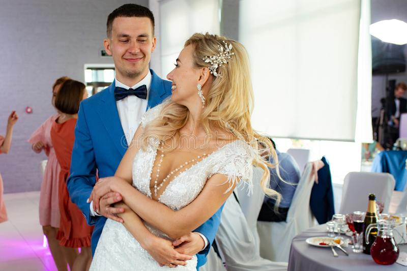 Young beautiful couple of newlyweds bride and groom during a wedding party dance. Love and lovestory of wife and husband before royalty free stock image