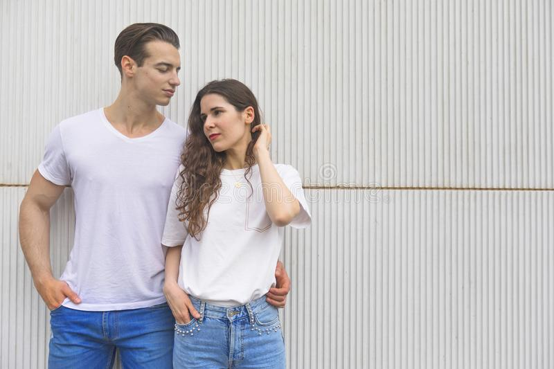 Young beautiful couple posing wearing jeans and t-shirt stock photography