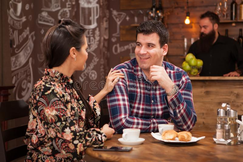 Young beautiful couple in restaurant showing affection. stock photos