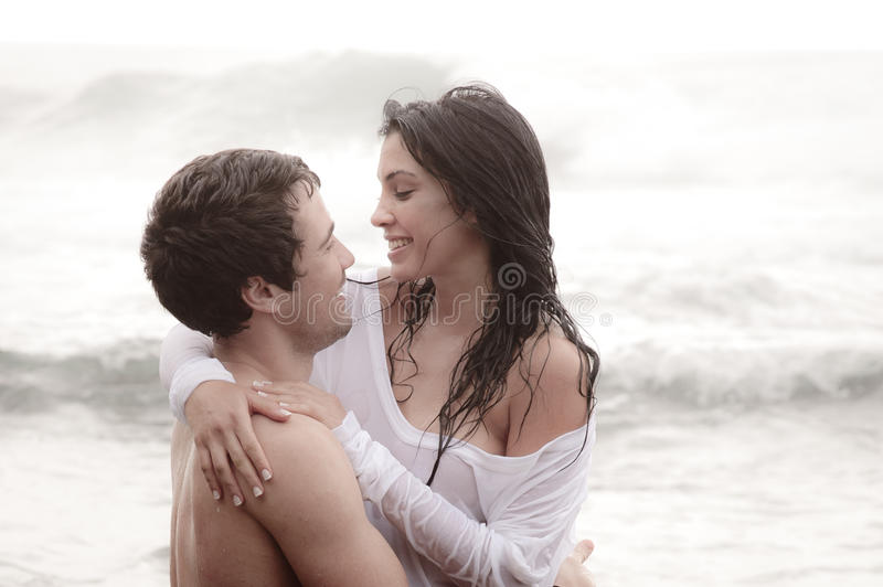 Young beautiful couple sharing an intimate moment royalty free stock image