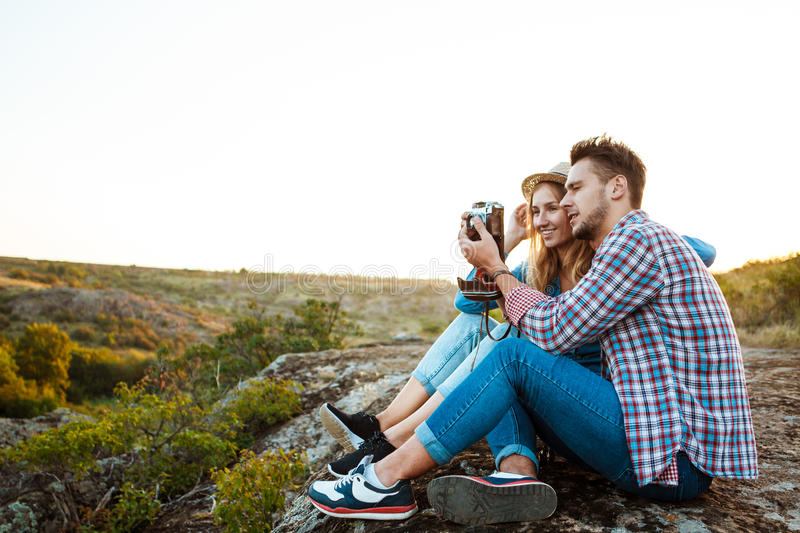 Young beautiful couple smiling, taking picture of canyon landscape. royalty free stock photos